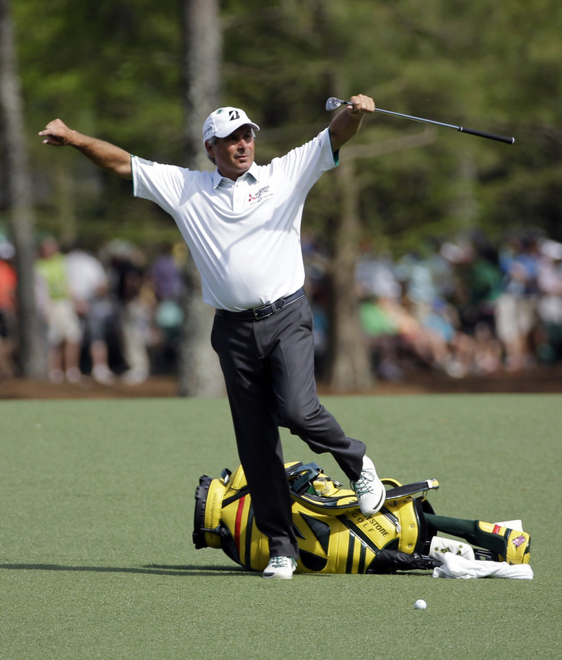 Photo - Fred Couples steps over his bag before hitting on the 13th fairway during the second round of the Masters golf tournament Friday, April 11, 2014, in Augusta, Ga. (AP Photo/David J. Phillip)