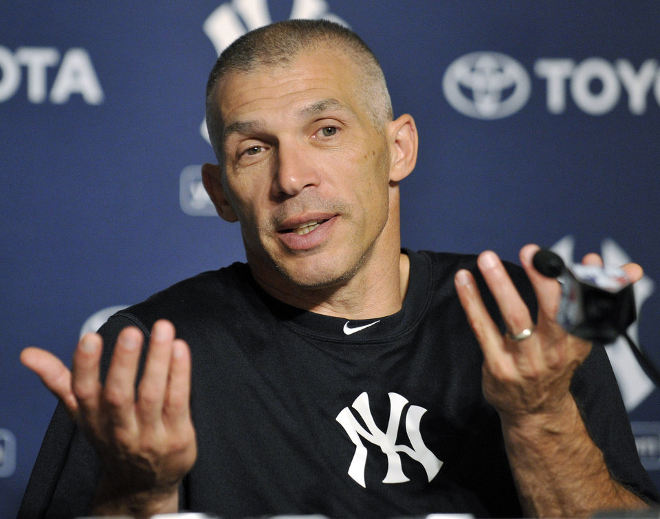 New York Yankees manager Joe Girardi talks to the media before a baseball practice Friday, Oct. 5, 2012, at Yankee Stadium in New York. (AP Photo/Bill Kostroun)