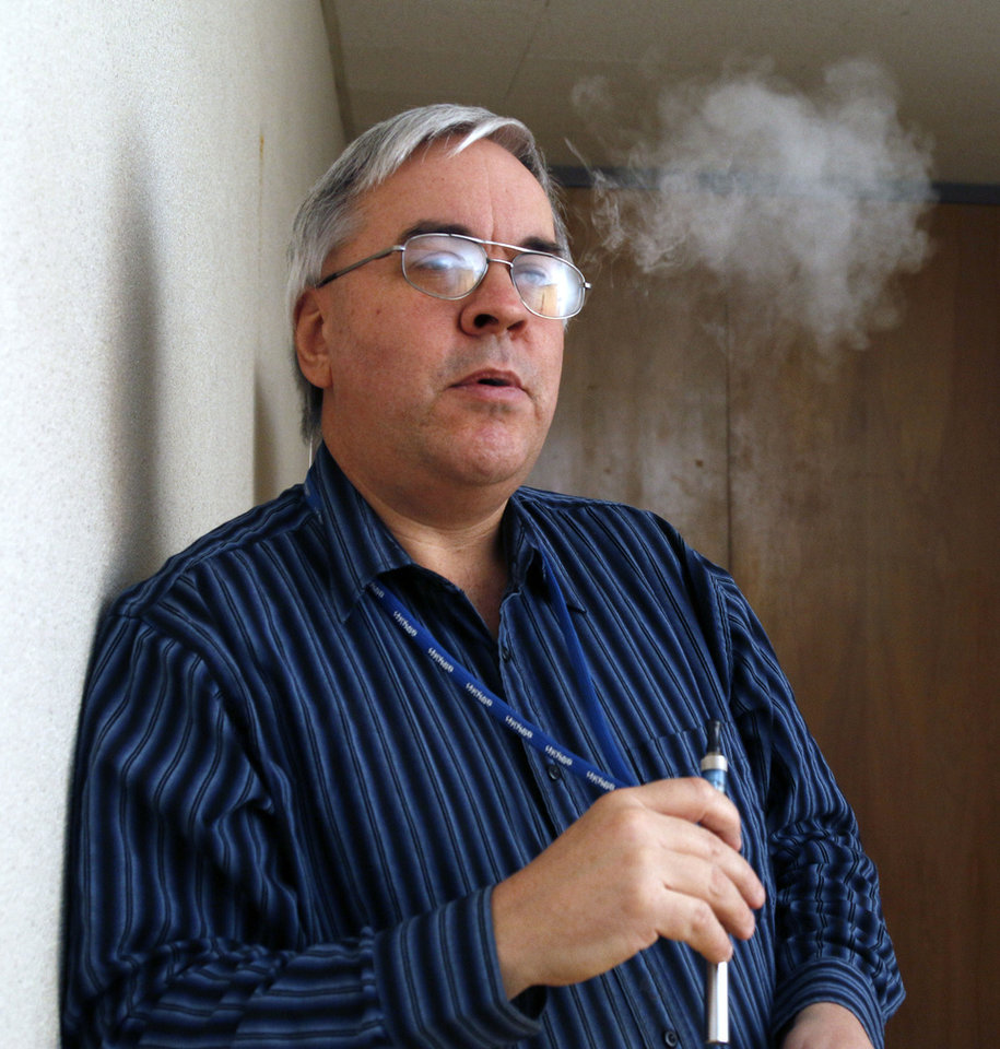 Photo - Todd Malicoate is a music professor at Oklahoma State University in Stillwater, OK, who uses an e-cigarette, Monday, October 21, 2013. The school is considering the banning of e-cigarettes.  Photo by Paul Hellstern, The Oklahoman