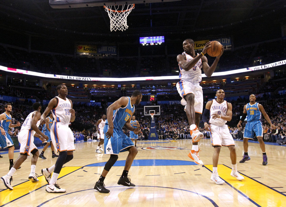 Photo - Oklahoma City's Serge Ibaka (9) grabs a rebound during the NBA basketball game between Oklahoma City Thunder and New Orleans Hornet, Wednesday, Feb. 2, 2011 at the Oklahoma City Arena. Photo by Sarah Phipps, The Oklahoman