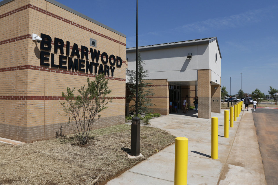 Photo -  Left: This is the newly rebuilt Briarwood Elementary School at 14901 S Hudson in Oklahoma City.    PAUL HELLSTERN -  Oklahoman