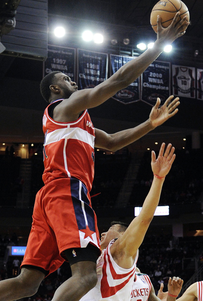 Washington Wizards\' Chris Singleton, left, jumps into Houston Rockets\' Jeremy Lin, right, in the first half of an NBA basketball game, Wednesday, Dec. 12, 2012, in Houston. Singleton was charged with a foul on the play. (AP Photo/Pat Sullivan)