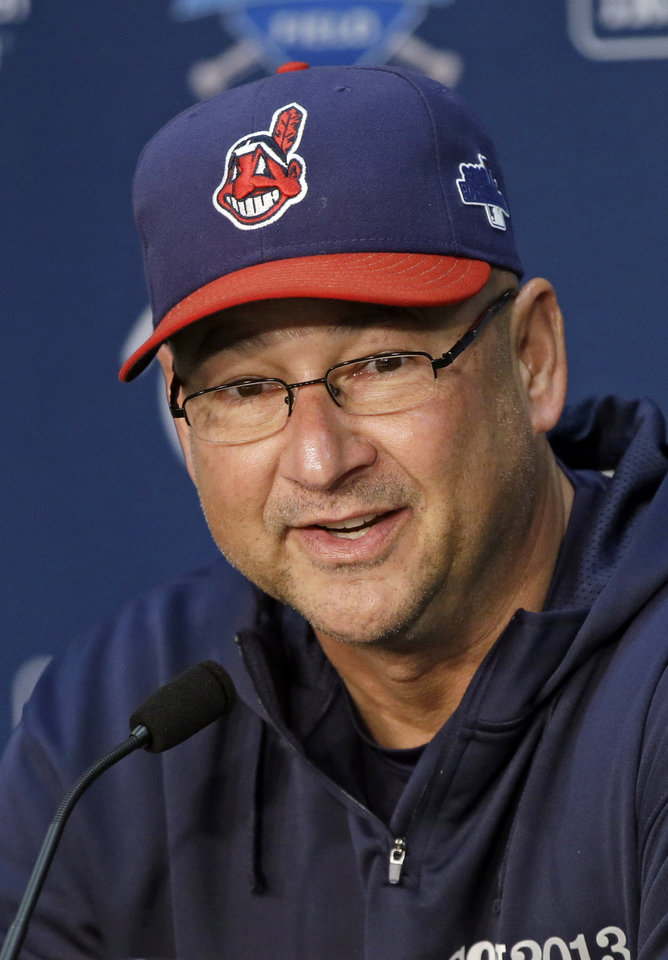 Photo - FILE - In this Oct. 1, 2013, file photo, Cleveland Indians manager Terry Francona answers questions during news conference before practice for the American League wild-card baseball game in Cleveland. Francona was named the AL manager of the year by the Baseball Writers' Association of America, Tuesday, Nov. 12, 2013. (AP Photo/Mark Duncan, File)