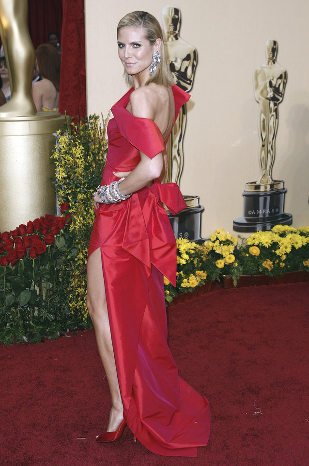 Photo - Heidi Klum's gown by Roland Mouret was architectural, a nice change from all the draping and flowing columns. Klum always looks smashing in red.  ap photo