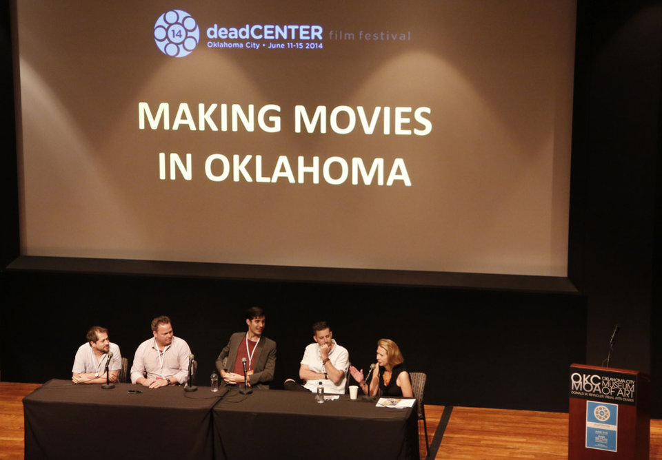 Photo -  Jill Simpson, right, with the Oklahoma Film and Music Office, leads a panel Friday on making movies in Oklahoma during the deadCenter Film Festival in Oklahoma City. Photo By Steve Gooch, The Oklahoman   Steve Gooch -