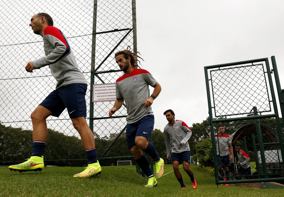 Photo - United States players jog into a practice field during a training session at the Sao Paulo FC training center in Sao Paulo, Brazil, Tuesday, June 10, 2014. The U.S. will play in group G of the 2014 soccer World Cup. (AP Photo/Julio Cortez)