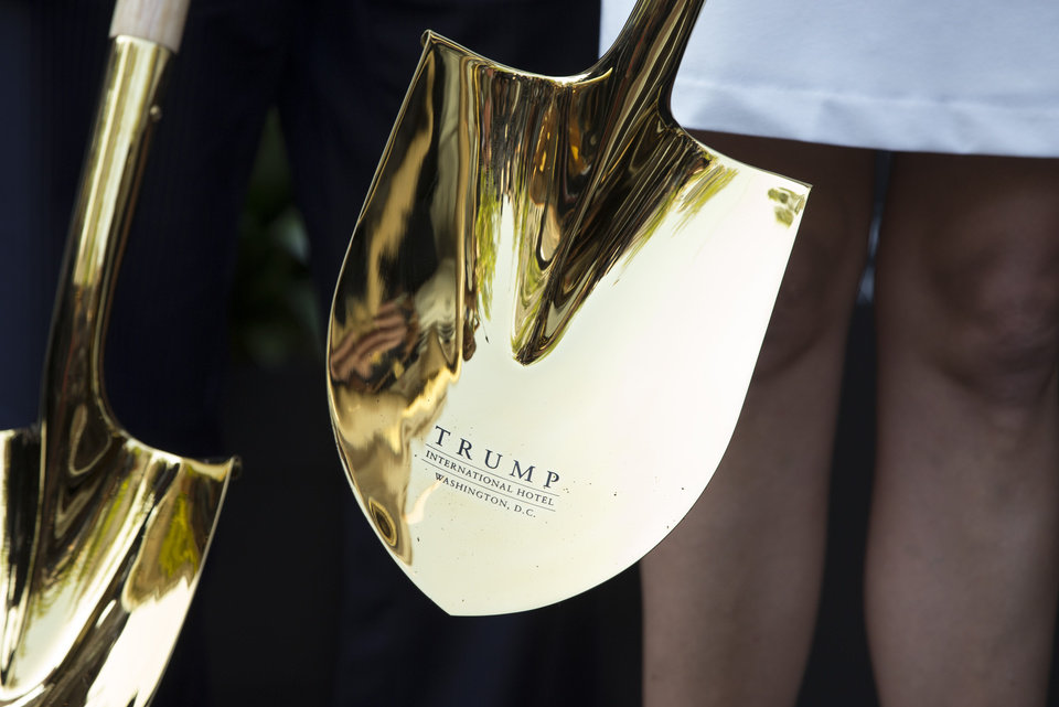Photo - A shovel with the Tump logo is sheen during a ground breaking ceremony for the Trump International Hotel on the site of the Old Post Office in Washington, Wednesday, July 23, 2014. (AP Photo)