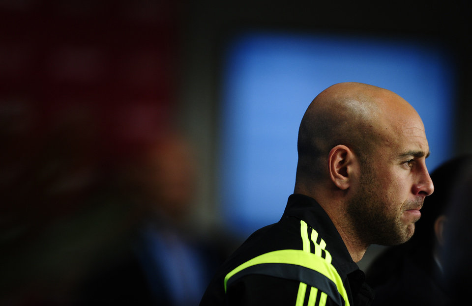 Photo - Spain's goalkeeper Pepe Reina attends an official press conference the day before the group B World Cup soccer match between Spain and Australia at the at the Arena da Baixada stadium in Curitiba, Brazil, Sunday, June 22, 2014. Spain will play in group B of the Brazil 2014 World Cup. (AP Photo/Manu Fernandez)