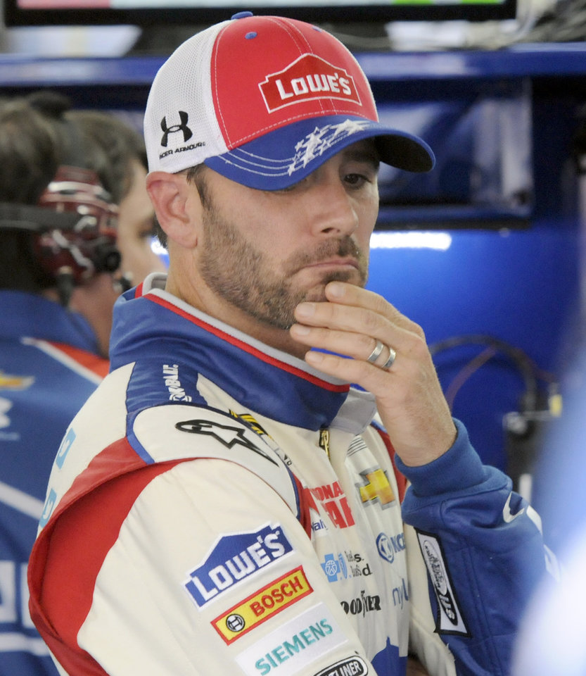 Photo - Driver Jimmie Johnson waits by his car before practice for Saturday's NASCAR Sprint Cup series auto race at Charlotte Motor Speedway in Concord, N.C., Friday, May 16, 2014. (AP Photo/Mike McCarn)