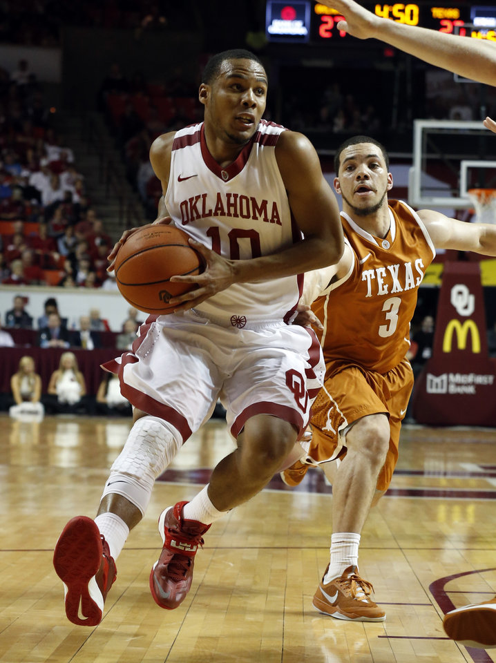 Photo - Oklahoma's Jordan Woodard (10) drives to the lane with Texas Longhorn's Javan Felix (3) trailing as the University of Oklahoma Sooners (OU) men play the Texas Longhorns (TU) in NCAA, college basketball at The Lloyd Noble Center on Saturday, March 1, 2014  in Norman, Okla. Photo by Steve Sisney, The Oklahoman