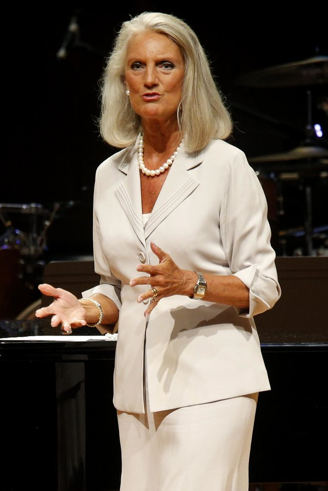 Photo - Evangelist Anne Graham Lotz, above left, daughter of evangelist Billy Graham, speaks, and gospel recording artist Sandi Patty, above right, performs Tuesday during the Church of God Convention at Crossings Community Church, 14600 N Portland, in Oklahoma City.  Photos by Bryan Terry, The Oklahoman  BRYAN TERRY