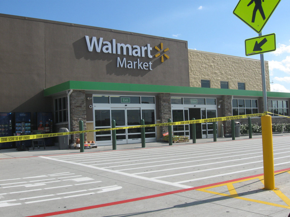 The Walmart Market, 7520 E Reno Ave., is where a man was shot and killed after holding a 2-year-old girl hostage, Midwest City Assistant Police Chief Sid Porter said. The store was closed for several hours while officers processed the scene. Photo by Matt Dinger, The Oklahoman <strong></strong>