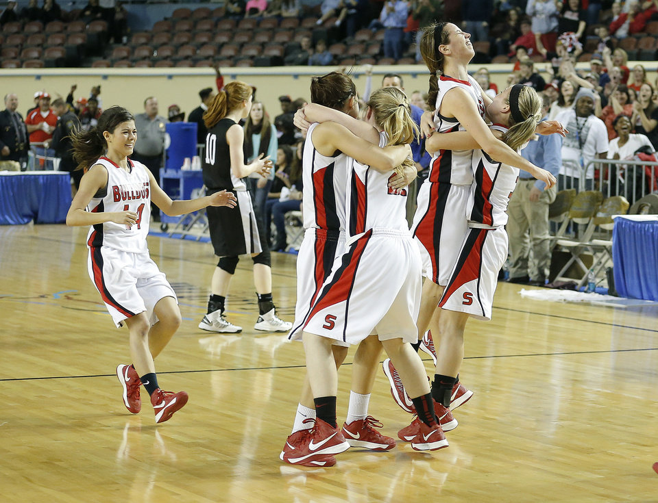 Sulphur celebrates their win over Perkins-Tyron following the 3A girls state high school basketball championship at the State Fair Arena in Oklahoma City, Saturday, March 9, 2013. Photo by Sarah Phipps, The Oklahoman