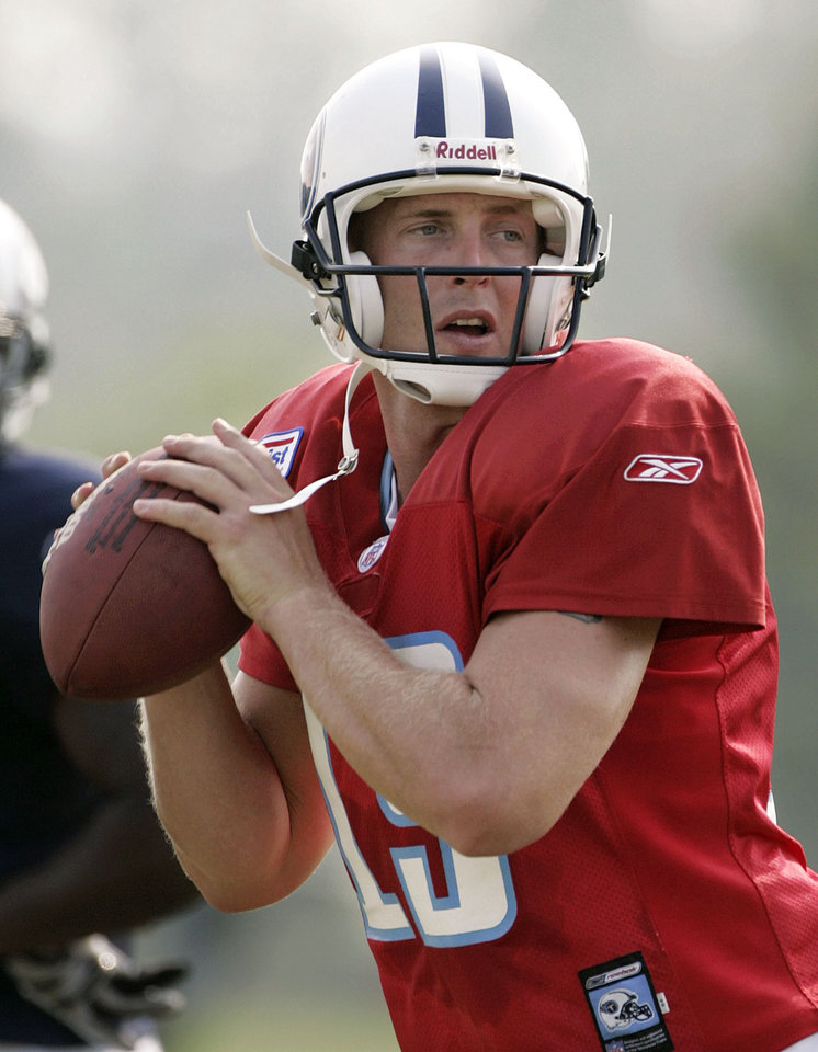 Photo - ** FILE **     NFL FOOTBALL: Tennessee Titans quarterback Jason White throws during training camp July 31, 2005 in Nashville, Tenn. White, who won the 2003 Heisman Trophy at the University of Oklahoma (OU), announced Thursday, Aug. 11, 2005, that he is ending his attempt at playing professional football because of his knees. (AP Photo/Mark Humphrey, file)