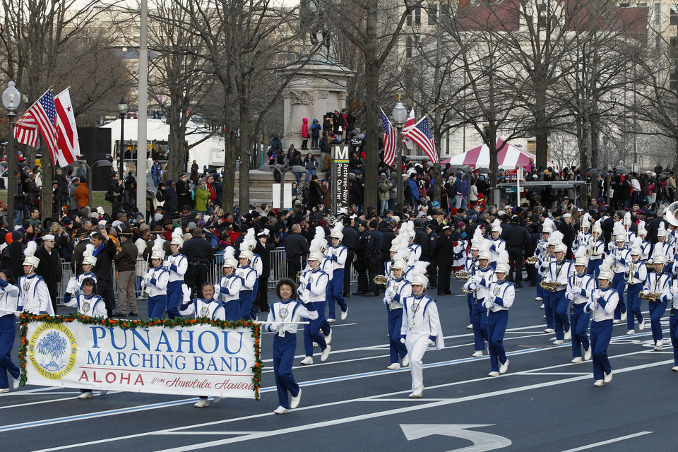 Photo - The Punahou Band and JROTC, Punahou School, Honolulu, Hawaii, performs in President Barack Obama's inaugural parade in Washington, Monday, Jan. 21, 2013, following the president's ceremonial swearing-in ceremony during the 57th Presidential Inauguration. ( AP Photo/Jose Luis Magana) ORG XMIT: DCJL120