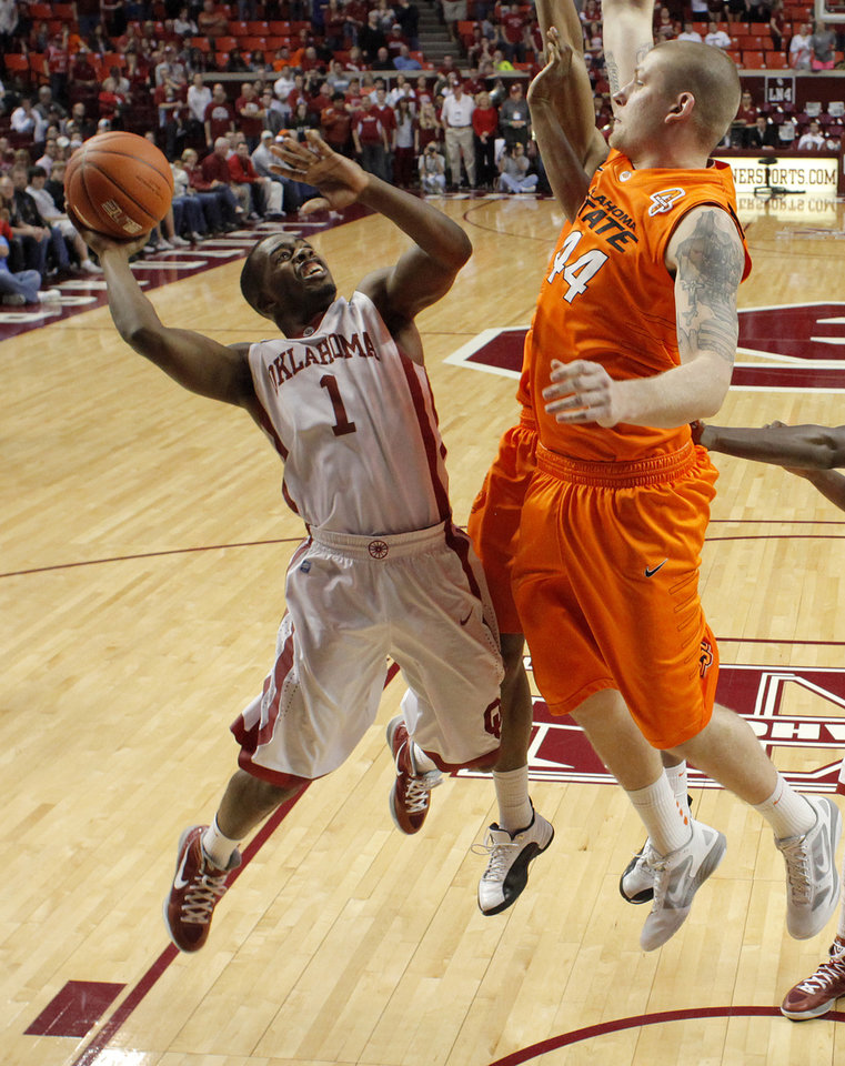 Oklahoma\'s Sam Grooms (1) puts up a shot beside Oklahoma State\'s Philip Jurick (44) during the Bedlam men\'s college basketball game between the University of Oklahoma Sooners and the Oklahoma State Cowboys in Norman, Okla., Wednesday, Feb. 22, 2012. Oklahoma won 77-64. Photo by Bryan Terry, The Oklahoman