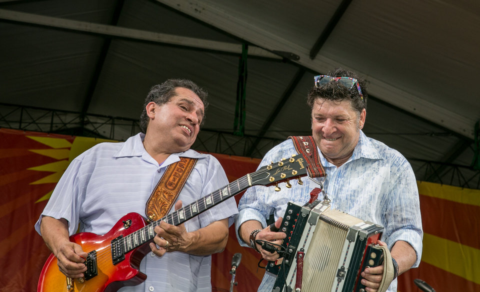 Photo - Freddie Pate on guitar, jams with Wayne Toups and the ZyDeCajun band at the Acura stage during the New Orleans Jazz and Heritage Festival in New Orleans, Friday, April 26, 2013. (AP Photo/Doug Parker)