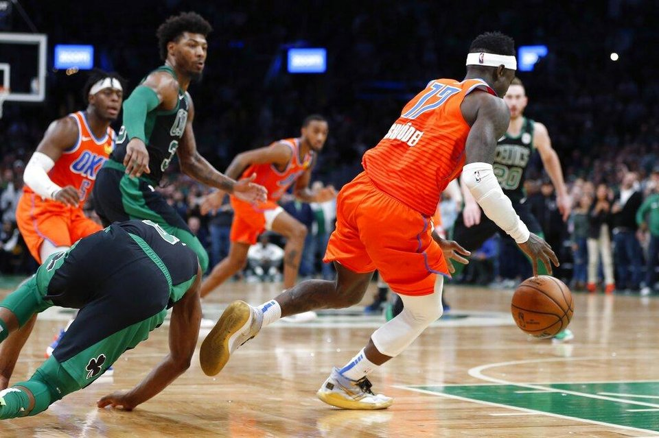 Photo - Oklahoma City Thunder's Dennis Schroder (17) steals the ball from Boston Celtics' Kemba Walker (8) during the second half of an NBA basketball game, Sunday, March, 8, 2020, in Boston. (AP Photo/Michael Dwyer)