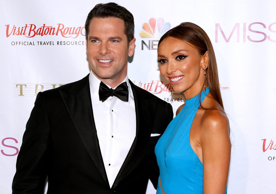 Photo - Pageant hosts Thomas Roberts, left, and Giuliana Rancic pose during a red carpet event before the Miss USA 2014 pageant in Baton Rouge, La., Sunday, June 8, 2014. (AP Photo/Jonathan Bachman)