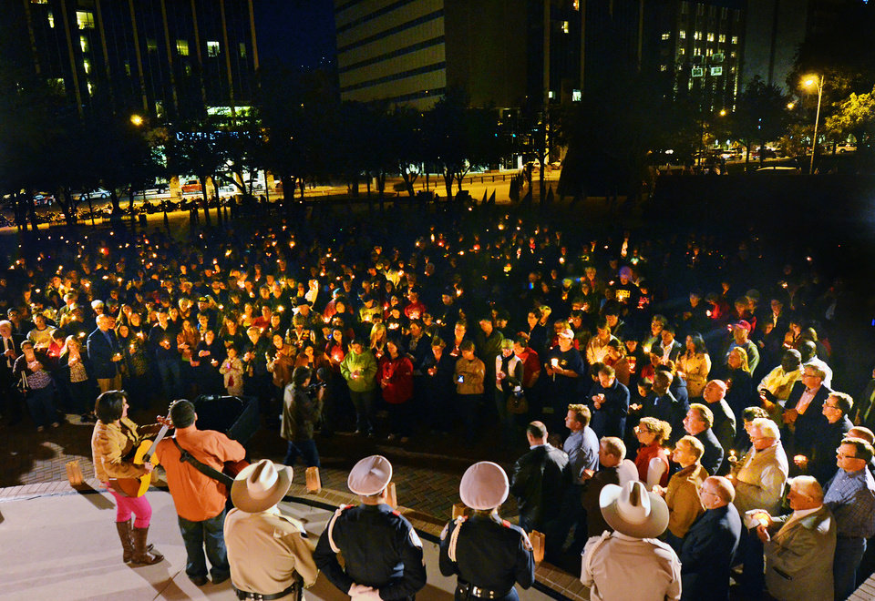 Peoplenders gather in Centennial Plaza in Midland, Texas on Saturday, Nov. 17, 2012 for a candlelight vigil held in honor of four veterans who were killed when a freight train hit a parade float Thursday. (AP Photo/Midland Reporter-Telegram, James Durbin)