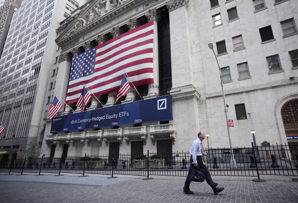 Photo - FILE - The New York Stock Exchange is shown, Tuesday, Aug. 9, 2011 file photo taken in New York. Global stock markets were muted Thursday Aug. 28, 2014 ahead of U.S. economic data and possible policy announcements from Japan.(AP Photo/Mark Lennihan, File)