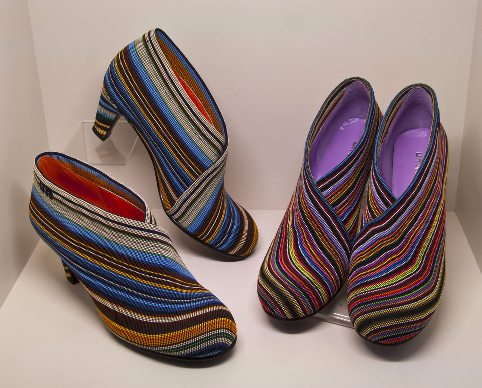 Photo - Colorful stripes add something new to fall booties (United Nudes, $230). (MCT)