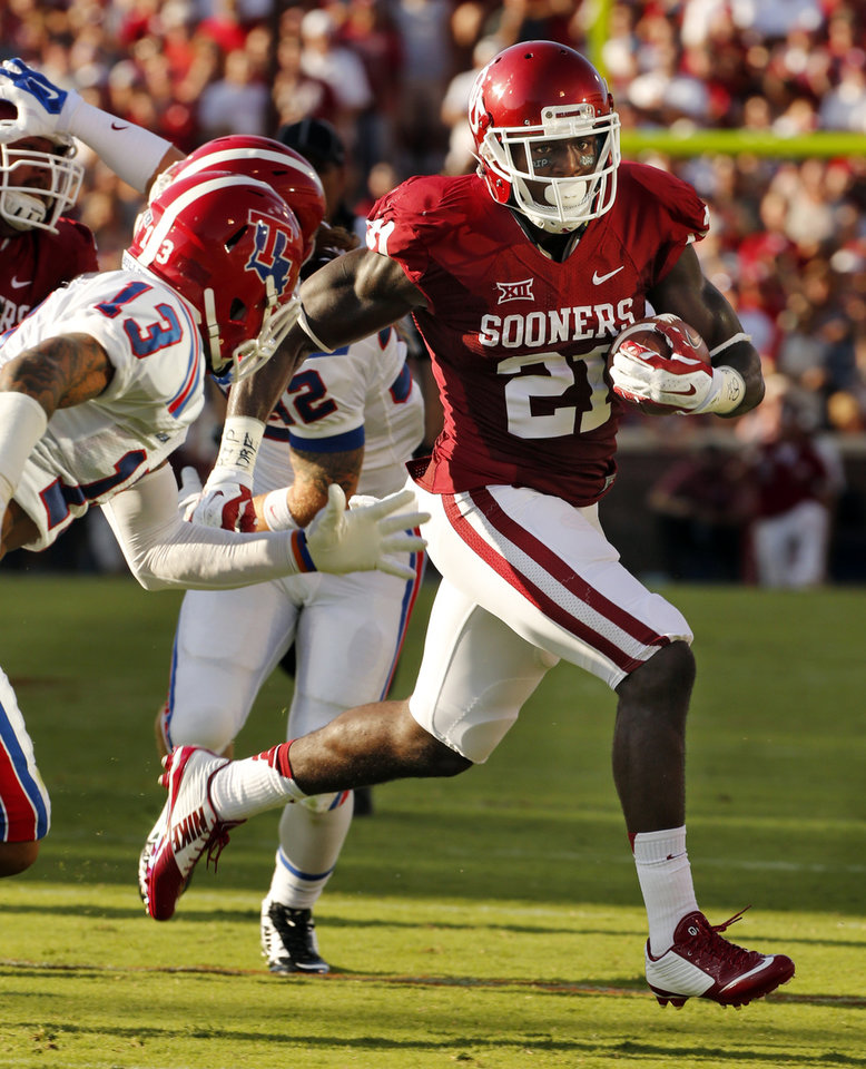 Photo - Oklahoma Sooner Keith Ford (21) scores the first touchdown of the game during a college football game between the University of Oklahoma Sooners (OU) and the Louisiana Tech Bulldogs at Gaylord Family-Oklahoma Memorial Stadium in Norman, Okla., on Saturday, Aug. 30, 2014. Photo by Steve Sisney, The Oklahoman