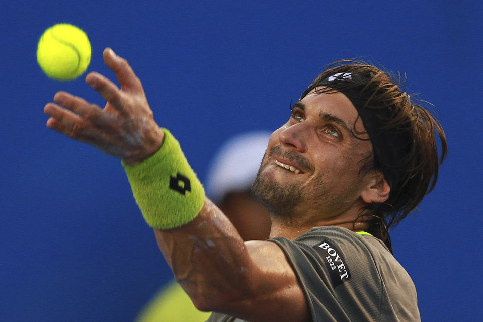 Photo - Spain's David Ferrer serves to South Africa's Kevin Anderson at the Mexican Tennis Open in Acapulco, Mexico, Thursday, Feb. 27, 2014. (AP Photo/Hugo Avila, JAM MEDIA)