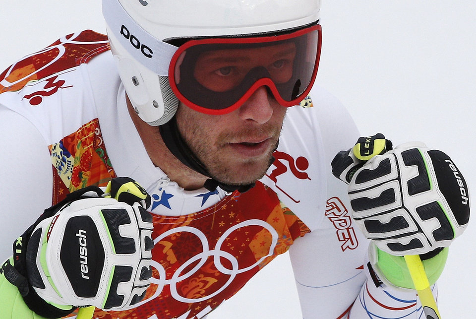Photo - United States' Bode Miller pauses in the finish area after completing Men's super combined downhill training at the Sochi 2014 Winter Olympics, Tuesday, Feb. 11, 2014, in Krasnaya Polyana, Russia. (AP Photo/Christophe Ena)