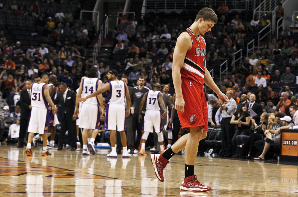 Photo -   Portland Trail Blazers' Meyers Leonard, right, walks off the court dejectedly during the second half of an NBA basketball game against the Phoenix Suns, Wednesday, Nov. 21, 2012, in Phoenix. The Suns defeated the Trail Blazers 114-87. (AP Photo/Ross D. Franklin)