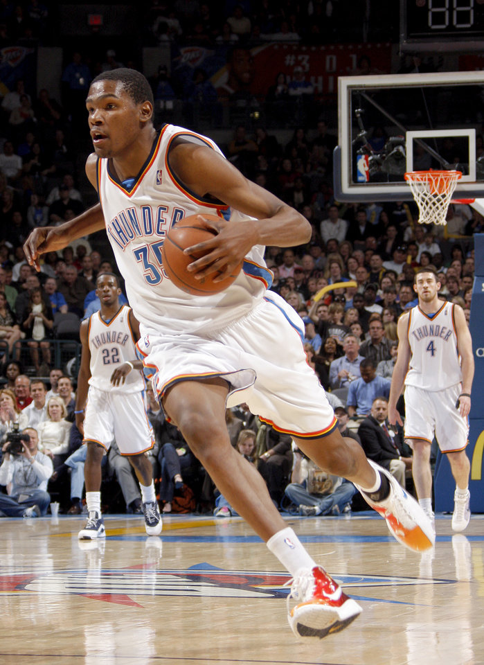 Photo - Oklahoma City's Kevin Durant (35) drive to the basket during the NBA game between Oklahoma City and San Antonio, Tuesday April 7, 2009, at the Ford Center in  Oklahoma CIty. Photo by Brenda O'Brian. The Oklahoman