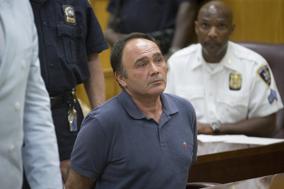 Photo - Besik Kelly attends his arraignment at Manhattan Supreme Court, Wednesday, July 2, 2014, in New York. Manhattan District Attorney Cyrus R. Vance Jr. and city Department of Investigation Commissioner Mark Peters announced earlier that morning the indictment of several individuals and businesses on charges including grand larceny, fraud, forgery, and evidence tampering through a building site safety inspection scam. (AP Photo/John Minchillo)