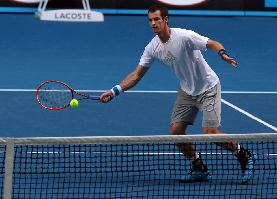 Photo - Andy Murray of Britain hits a ball during a training session on the Rod Laver Arena, at the Australian Open tennis championship in Melbourne, Australia, Tuesday, Jan. 21, 2014.  Wimbledon champion Murray faces Roger Federer, winner of 17 Grand Slams, at the Australian Open quarterfinal Wednesday.(AP Photo/Shuji Kajiyama)