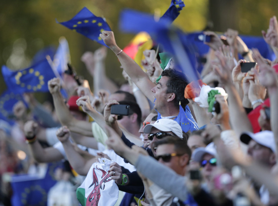 European fan celebrate their comeback win at the Ryder Cup PGA golf tournament Sunday, Sept. 30, 2012, at the Medinah Country Club in Medinah, Ill. (AP Photo/Charlie Riedel)  ORG XMIT: PGA234