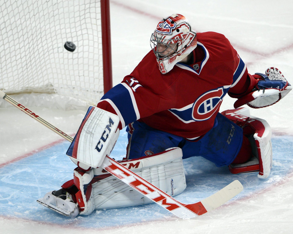 Photo - Montreal Canadiens goalie Carey Price (31) lets in the second goal of the game against the New Jersey Devils during second period National Hockey League action, Tuesday, Jan. 14, 2014, in Montreal. (AP Photo/The Canadian Press, Ryan Remiorz)