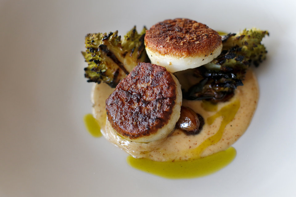 Photo -  Patrono's new menu includes seared diver scallops, which arrive to the table charred to perfection but still sweet and moist in the center. [Photo by Bryan Terry, The Oklahoman]