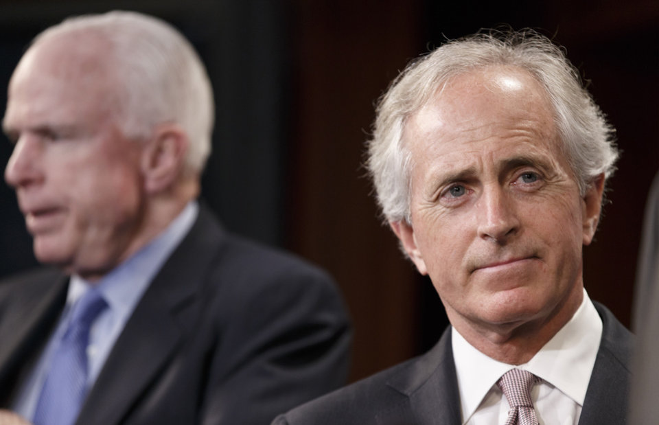 Photo - Sen. Bob Corker, R-Tenn., right, accompanied by Sen. John McCain, R-Ariz., listens during a news conference on Capitol Hill in Washington, Wednesday, April 30, 2014. Corker was the only Republican to cross party lines and vote