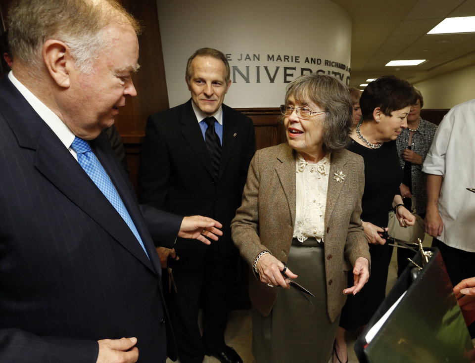 President David L. Boren, left, directs Jan Marie Crawford and artist Mike Wimmer as they prepare to cut a ribbon marking the opening of the remodeled Crawford University Club in the Memorial Student Union of the University of Oklahoma (OU) on Tuesday, April 9, 2013 in Norman, Okla. At far right is Molly Boren. Photo by Steve Sisney, The Oklahoman