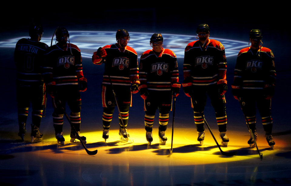 Photo - Members of Oklahoma City Barons line up during introductions before their AHL hockey game inside the Cox Convention Center in Oklahoma City, Friday, April 18, 2014. Photo by Bryan Terry, The Oklahoman