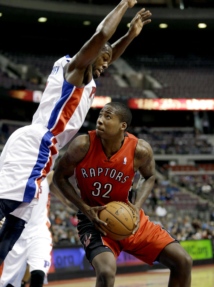 Detroit Pistons guard Rodney Stuckey (3) defends Toronto Raptors forward Ed Davis (32) in the first half of a preseason NBA basketball game in Auburn Hills, Mich., Wednesday, Oct. 10, 2012. (AP Photo/Paul Sancya)