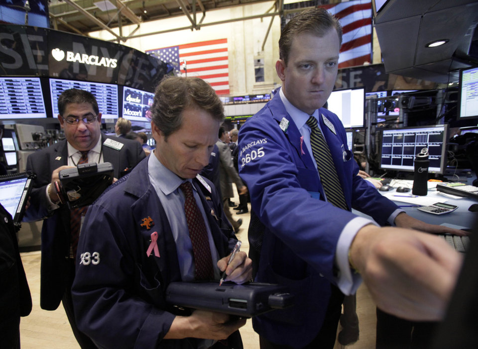 Photo -   Specialist Edward Zelles, right, works on the floor of the New York Stock Exchange Thursday, Oct. 18, 2012. The U.S. stock market headed slightly lower on Thursday, following a leap in claims for unemployment benefits and weak results from American Express. (AP Photo/Richard Drew)