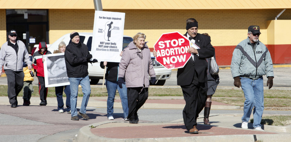 Anti-abortion demonstrators march along NW 23 Street on Monday, walking about 2.4 miles from Our Lady�s Cathedral, 3214 N Lake Ave., to the state Capitol. Photo by Paul B. Southerland, The Oklahoman