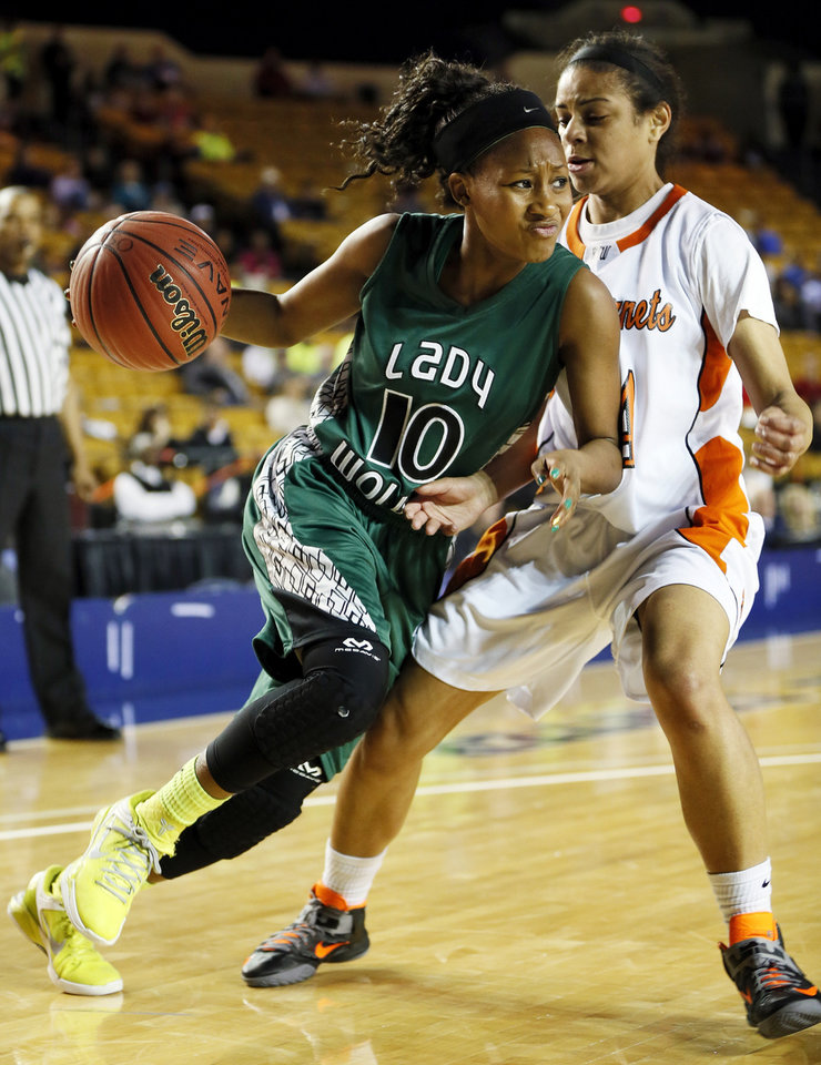 Edmond Santa Fe's Cameerah Graves (10) drives against Booker T. Washington's Mikayla Alexander (24)  during a Class 6A girls high school basketball game in the semifinals of the state tournament at the Mabee Center in Tulsa, Okla., Friday, March 8, 2013. Photo by Nate Billings, The Oklahoman
