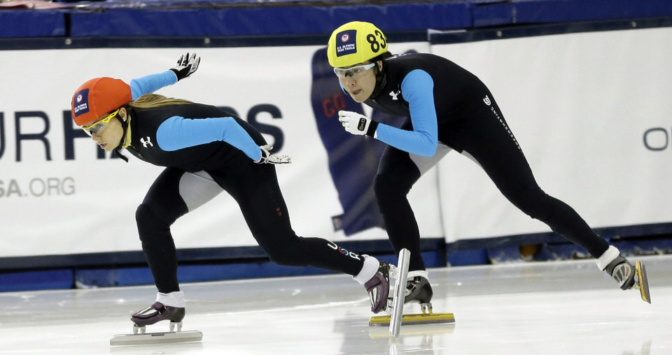 Photo - Jessica Smith, left, and Sarah Chen compete in the women's 500 meters during the U.S. Olympic U.S. short track speedskating trials Saturday, Jan. 4, 2014, in Kearns, Utah. (AP Photo/Rick Bowmer)