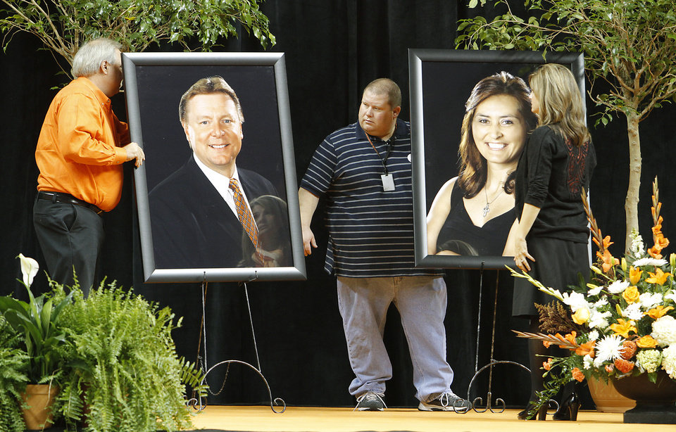 Photo - Crews prepare the stage with photos of Kurt Budke and Miranda Serna before the start of the memorial service for Oklahoma State head basketball coach Kurt Budke and assistant coach Miranda Serna at Gallagher-Iba Arena on Monday, Nov. 21, 2011 in Stillwater, Okla. The two were killed in a plane crash along with former state senator Olin Branstetter and his wife Paula while on a recruiting trip in central Arkansas last Thursday. Photo by Chris Landsberger, The Oklahoman
