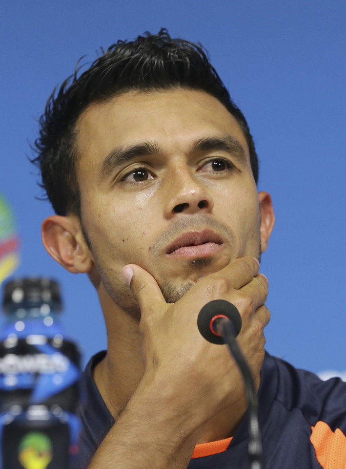 Photo - Costa Rica's Giancarlo Gonzalez listens to questions during a press conference the day before the group D World Cup soccer match between Italy and Costa Rica at at the Arena Pernambuco stadium in Recife, Brazil, Thursday, June 19, 2014. (AP Photo/Antonio Calanni)