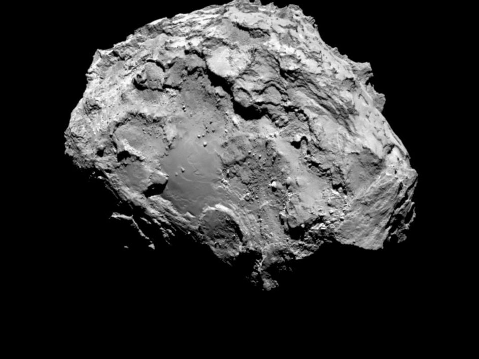 Photo - In this picture taken on Aug. 3, 2014 by Rosetta's OSIRIS narrow-angle camera Comet 67P/Churyumov-Gerasimenko is pictured from a distance of 285 kms. A mission to land the first space probe on a comet reaches a major milestone when the unmanned Rosetta spacecraft finally catches up with its quarry on Wednesday, Aug 6, 2014. It's a hotly anticipated rendezvous: Rosetta flew into space more than a decade ago and had to perform a series of complex maneuvers to gain enough speed to chase down the comet on its orbit around the sun. The image resolution is 5.3 metres/pixel. (AP Photo/ESA/Rosetta/MPS for OSIRIS Team )