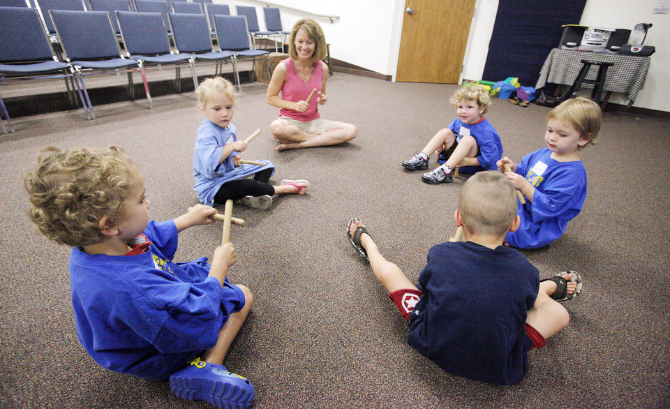 Instructor Julie Atyia works with 3- and 4-year-olds on a music project during an arts summer camp at the Edmond Fine Arts Institute. PHOTOS BY PAUL B. SOUTHERLAND, THE OKLAHOMAN