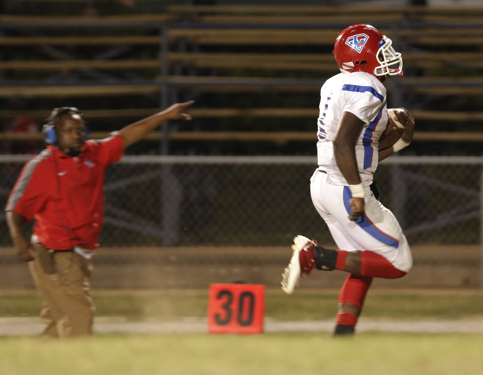 JM #1 Keshawn Shells breaks a long run for a touchdown as a coach points the way during the high school football game of John Marshall at Star Spencer, Thursday, September 26, 2013. Photo by Doug Hoke, The Oklahoman