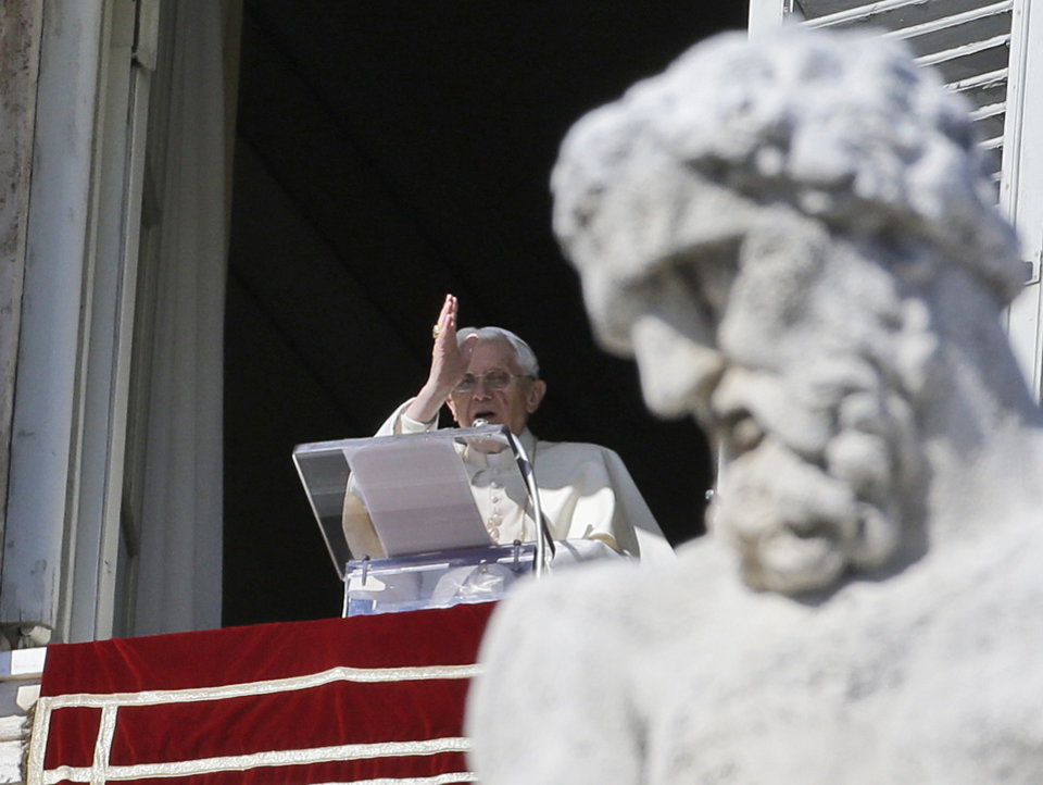 Pope Benedict XVI blesses the faithful from his studio\'s window overlooking St.Peter\'s square during the Angelus noon prayer, at the Vatican, Sunday, Feb. 10, 2013. (AP Photo/Gregorio Borgia)